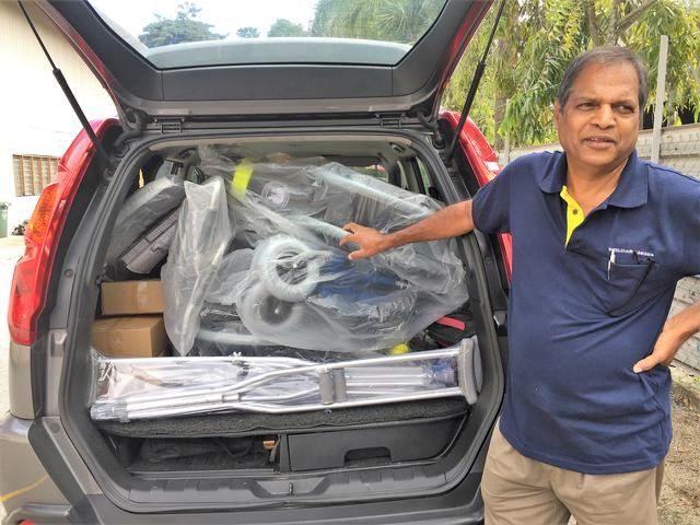 Raja fills his car with wheelchairs for delivery