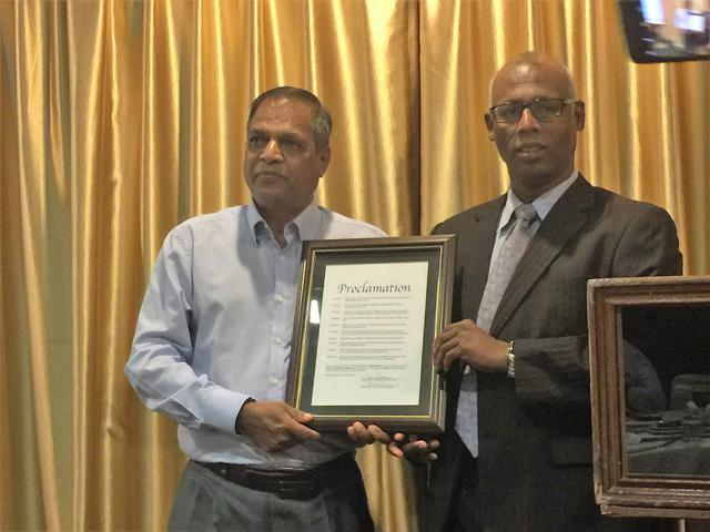 Micheal Tamil presents the Proclamation to Raja Renno
