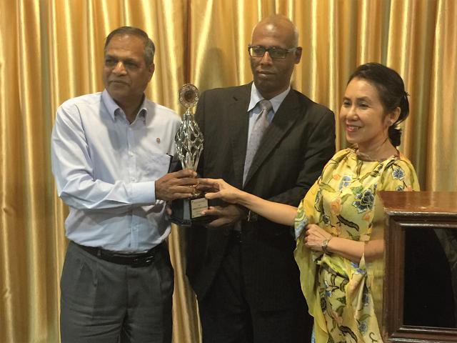 P A Council members, Eng Huey Tan and Micheal Tamil, present award to Raja Renno